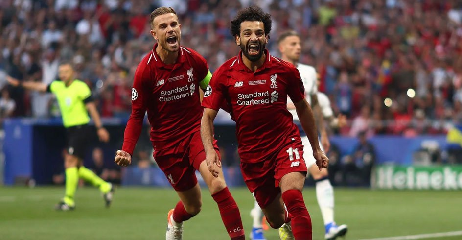 Henderson celebrates with Momo Salah
